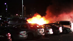1612 Big Car Fire in Parking Lot with Fire Trucks    - stock footage
