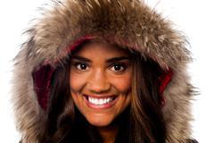 Stock Photo of Pretty African girl in fur hood