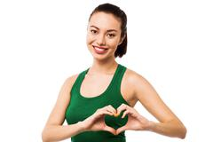 Stock Photo of Pretty teenager making heart symbol with hands