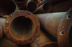 Rusty old pipes stacked up Stock Photos