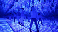 Boy and girl have fun in a mirrored room with blue lights Stock Footage