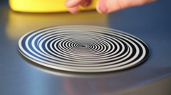 Striped hypnotic circle spiral spinning by human hand Stock Footage