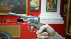 Little boy holding old pistol at Museum of the USSR Stock Footage