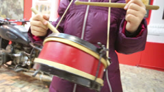 Little girl banging pioneer drum at Museum of the USSR Stock Footage