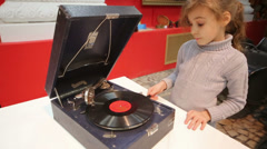 Little girl near old phonograph at Museum of the USSR Stock Footage