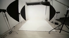 Photographic equipment and a white backdrop in studio. Stock Footage