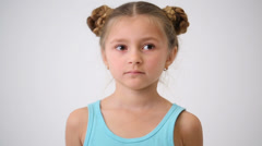 Close-up face of a little girl with an interesting hairdo Stock Footage