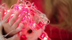 Flashing garland in form of stars at childrens hands - stock footage