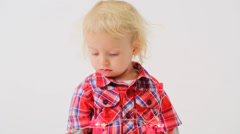 Cute little boy in modern clothes wrapped the garland Stock Footage