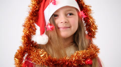 Girls in red caps Santa Claus wrapped tinsel and garland Stock Footage