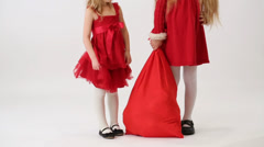 Two girls in the bell Santa Claus with a bag of gifts Stock Footage