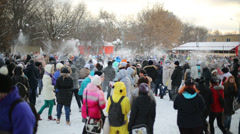 Many people are having fun throwing snowballs Stock Footage