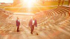 Old stadium arena. walking stairs. businessman. man male person Stock Footage