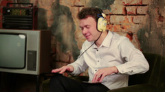 Man with headphones and two disks listens old radio Stock Footage