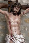 Figure of jesus on the cross carved in wood by the sculptor josé miguel tira Stock Photos