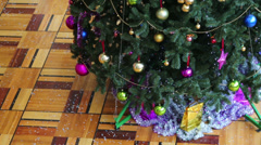 Little boy in mask run around Christmas tree with colorful balls Stock Footage