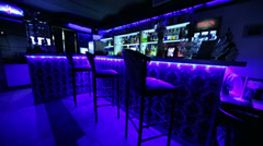 The bar counter in cafe with three chairs illuminated blue light Stock Footage
