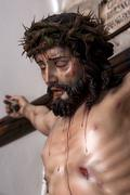 figure of jesus on the cross carved in wood by the sculptor josé miguel tira - stock photo