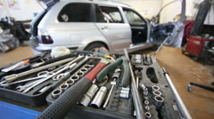 Toolbox full of tools for car repairing at service station Stock Footage