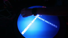 Hands of Dj plays music on Reactable in night club. Stock Footage