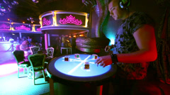Dj plays music on Reactable during DJ Solovey birthday party Stock Footage