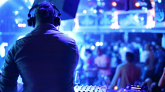 Back of DJ which dance at his workplace during party Stock Footage