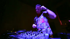 DJ mixes music tracks with CD-players and mixer in nightclub Stock Footage