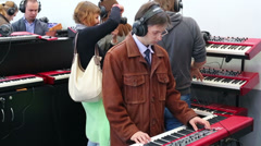 People play piano in Sokolniki Exhibition and Convention Centre - stock footage