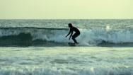 Stock Video Footage of Surfer Falls in Water