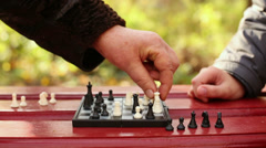 Grandmother and child hands move chessmen on chessboard Stock Footage