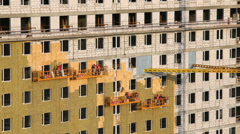 Weatherization works on building wall at construction site Stock Footage