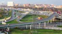 Car traffic on tiered road junction at intersection of highway Stock Footage