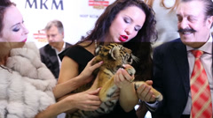 Circus actress, animal trainer Karina Bagdasarova with tiger cub Stock Footage