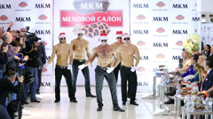 Male dance group performs in front of guests at salon Stock Footage