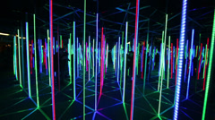 Moving through mirror labyrinth illuminated with colour lights Stock Footage