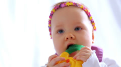 Little girl with headband in form of chaplet on her head - stock footage
