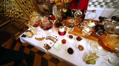 Table with tea accessoires, teapots and cups, dried fruits. Stock Footage