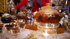Tea accessoires, teapots and cups on table in throne hall Stock Footage