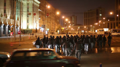 Anti-riot police detachment crosses street moving to Avenue. Stock Footage