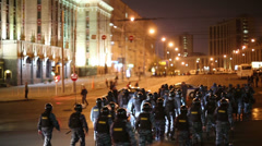 Anti-riot police detachment moves to Academician Sakharov Avenue Stock Footage