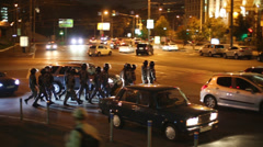 Group of soldieres of anti-riot police detachment crosses street Stock Footage