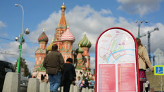 Brisk movement of peole at Red Square against St Basil Cathedral Stock Footage