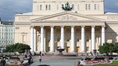 Building of Bolshoi Theatre and people around fountain Stock Footage