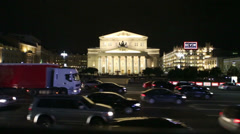 Car traffic against building of Bolshoi Theatre in evening. Stock Footage