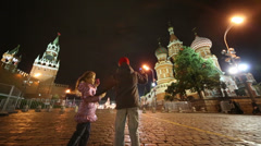 Children walk holding hands and shooting Red Square Stock Footage