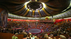 People move during performance intermission in Circus hall Stock Footage