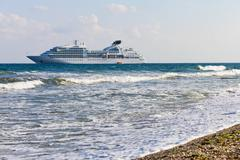Cruise liner near to the seacoast Stock Photos