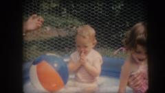 Vintage old film home movie baby children playing in pool Stock Footage