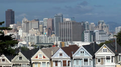 "View across Alamo Square Park towards the  ""Painted Ladies"" Victorian houses Stock Footage"