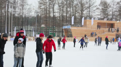People have rest on scating rink at Sokolniki park Stock Footage